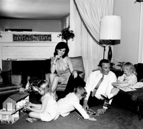 Family with children playing in living room Poster Print - Item # VARSAL255417658