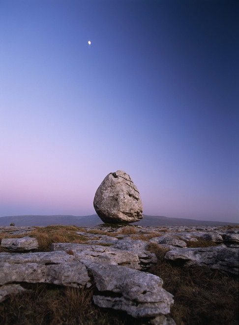 Boulder On Limestone Pavement At Dusk, With Moon And Ingleborough Hill Behind, Twisleton Scars Near Ingleton, Yorkshire Dales National Park, North Yorkshire, England. PosterPrint - Item # VARDPI2197027