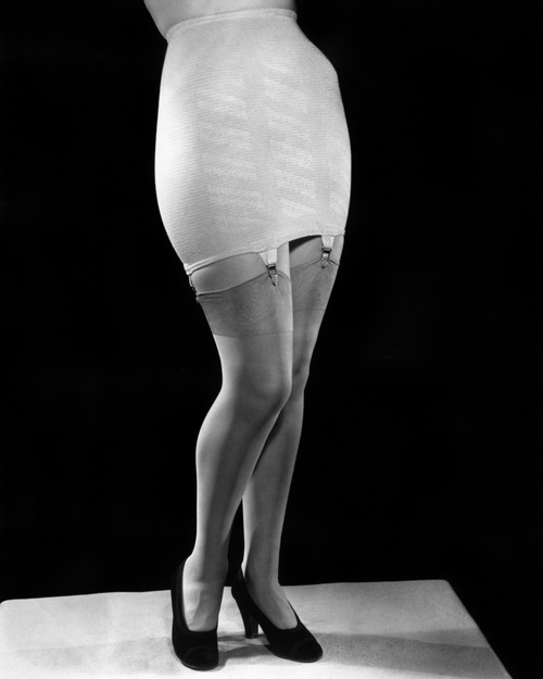 1940s Fashion Woman From Waist Down Wearing Girdle With Garters Clips Holding Silk Nylon Hose Stockings Print By Vintage - Item # VARPPI177396