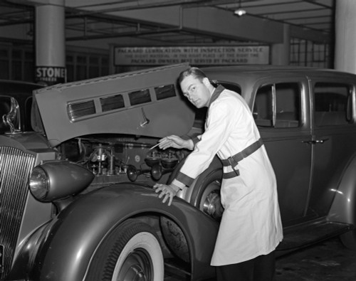 1940s Mechanic Looking At Camera Working Under Hood Of Car Wearing Work Smock Uniform Garage Print By Vintage Collection - Item # PPI177506LARGE
