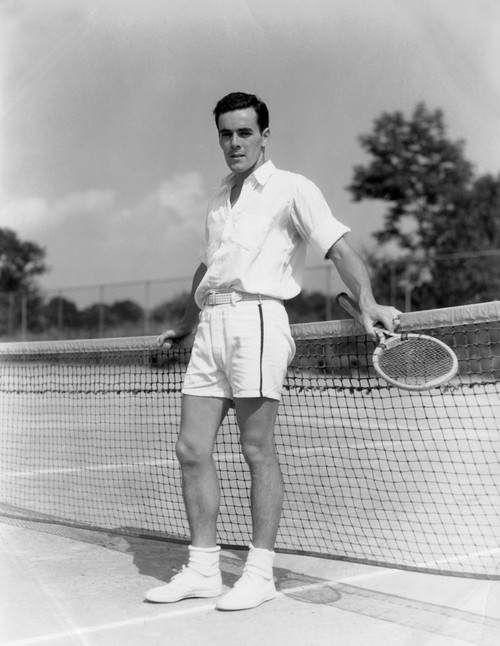 1930s Man Wearing Tennis Whites Standing Looking At Camera Holding Racket Hands On The Net Print By Vintage Collection - Item # PPI172473LARGE