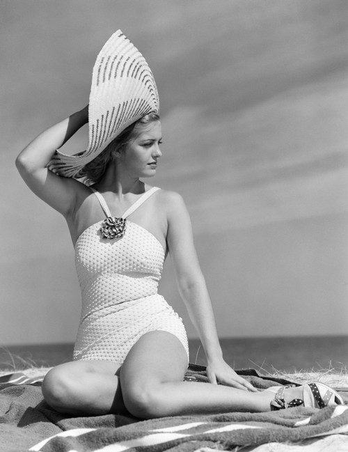 1930s-1940s Woman In White Bathing Suit On Beach Wearing Big Straw Hat Poster Print By Vintage Collection - Item # VARPPI177243