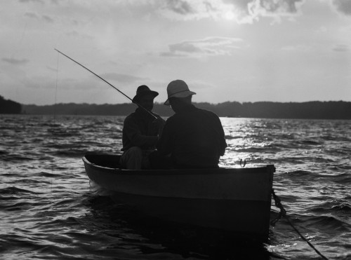 1930s Two Men Wearing Hats In Rowboat Fishing Silhouetted At Sunrise Poster Print By Vintage Collection - Item # VARPPI176452