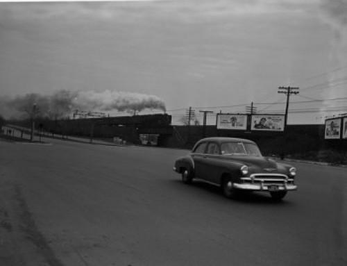 USA  Massachusetts  Boston  Car on road  steam train in the background Poster Print - Item # VARSAL255423869