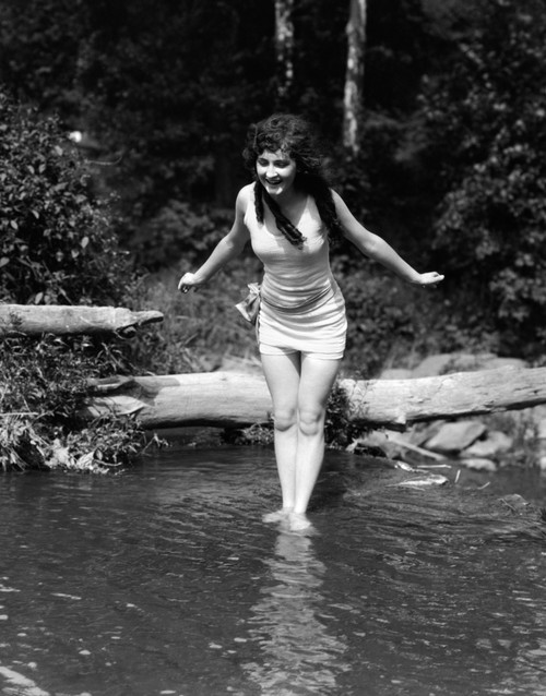 1920s Long-Haired Woman In Old Fashion Bathing Suit Standing In Pond With Feet In Water About To Dive Outdoor Print By - Item # PPI172410LARGE