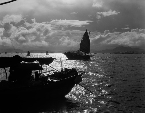 1920s-1930s Dramatic Sunset With Silhouetted Chinese Junks And Boats Hong Kong Harbor China Print By Vintage Collection - Item # PPI195640LARGE