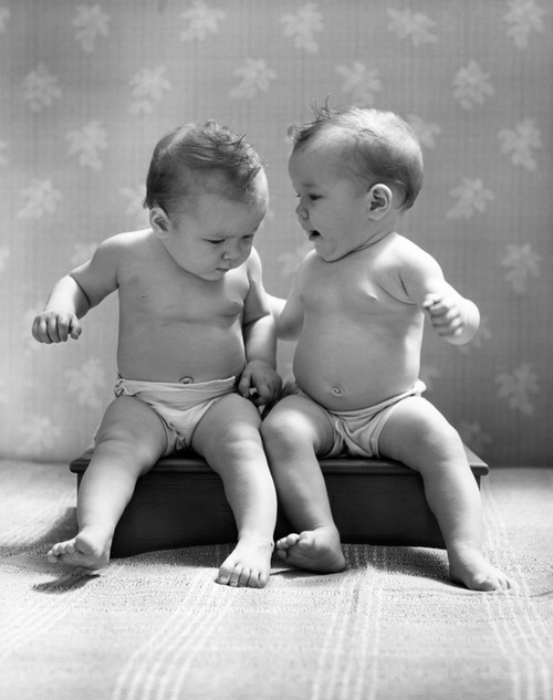 1930s-1940s Twin Babies Wearing Diapers Together Sitting On A Bench Side By Side Studio Print By Vintage Collection - Item # PPI177165LARGE