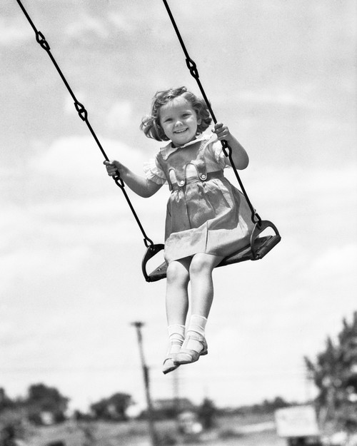 1930s-1940s Smiling Girl On Swing Outdoor Looking At Camera Poster Print By Vintage Collection - Item # VARPPI177427