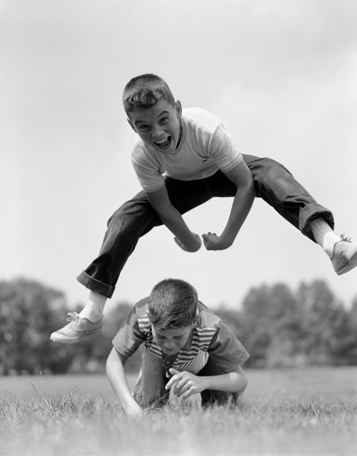 1960s Boys Playing Leap Frog Outside Sky Grass Jump Jumping Crouching Poster Print By Vintage Collection - Item # VARPPI177770