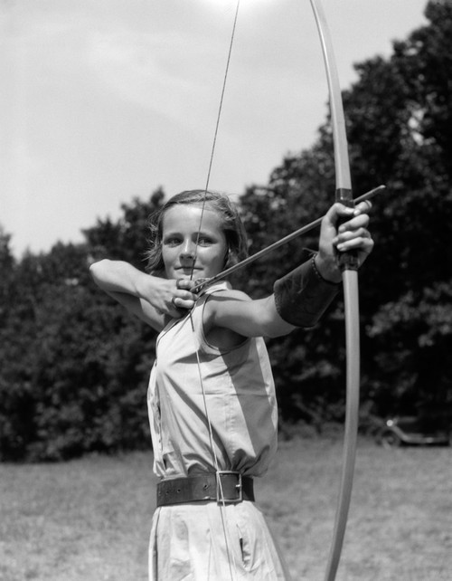 1930s Girl Wearing A Camp Jumper With Wide Leather Belt About To Release An Arrow From Bow Print By Vintage Collection - Item # VARPPI172395