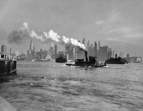 1930s-1933 Steam Engine Tug Boat And Staten Island Ferry Boats On Hudson River Against Manhattan Skyline New York City - Item # PPI195793LARGE