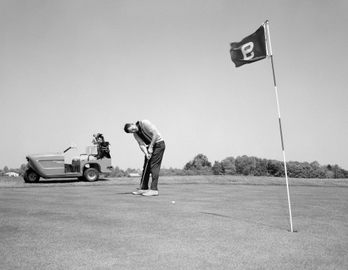 1960s Man Playing Golf Putting Golf Ball Towards Flag And Cup Hole On 9Th Green Spring Summer Outdoor Print By Vintage - Item # VARPPI172423