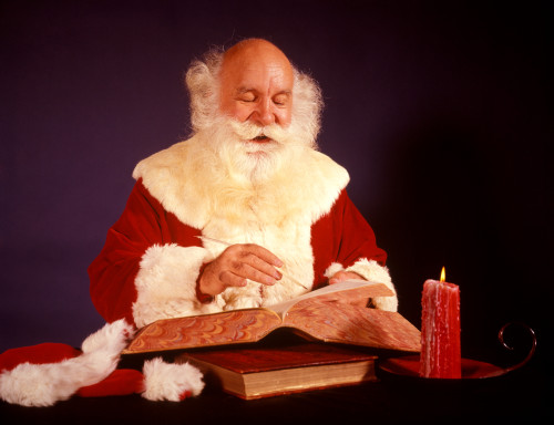1960s Bald Santa Claus Writing Or Checking List In Big Book By Candle Light Poster Print By Vintage Collection - Item # VARPPI177494