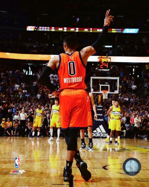 Russell Westbrook acknowledges the crowd after breaking the NBA record for the most triple doubles in a season on April 9, 2017 Photo Print - Item # VARPFSAAUA030
