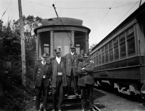 1910s-1920s 4 Men Conductors Motormen Public Transportation Transit Workers Posing In Front Of Trolley Car In Uniforms - Item # PPI194893LARGE