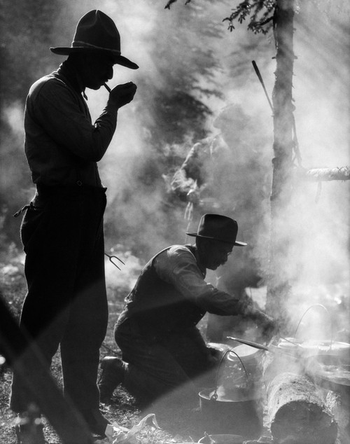 1920s Three Men Cowboys Camping One Man Smoking Pipe One Man Cooking Over Campfire Moody Silhouette Print By Vintage - Item # PPI178084LARGE