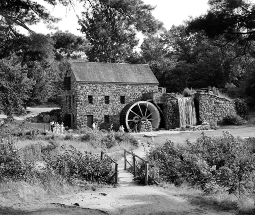 1960s People Tourists Visiting Rustic Grist Mill With Stone Structure Waterfall And Waterwheel Sudbury Massachusetts Usa - Item # VARPPI194053