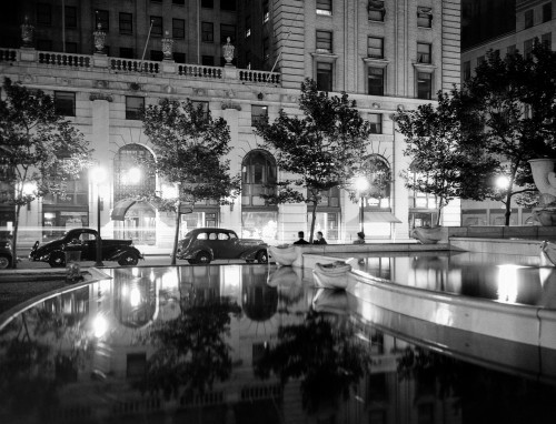 1930s Night Scene 5Th Avenue Tree Lined Sidewalk Cars Silhouetted Men Reflecting Water In Pulitzer Fountain Nyc Usa - Item # VARPPI178651