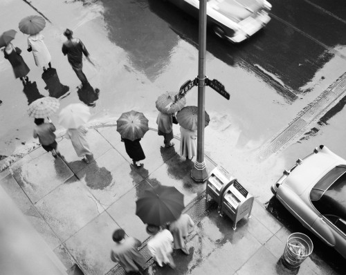1950s Aerial Of Street Corner In The Rain Pedestrians With Umbrellas Cars Wet Pavement Park Ave & 48Th Street New York - Item # PPI179520LARGE