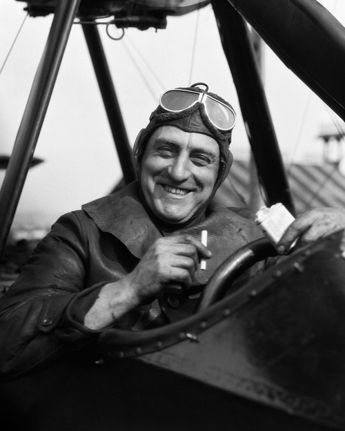 1920s Smiling Man Pilot In Cockpit Of Airplane Looking At Camera Taking Cigarette Out Of Pack Print By Vintage - Item # VARPPI172470