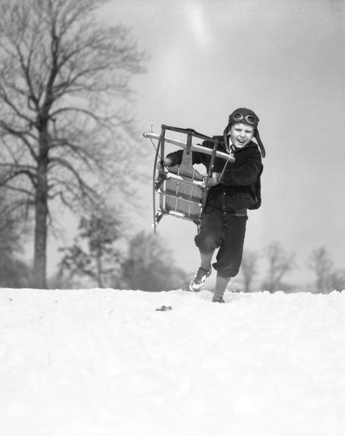 1930s Boy Wearing Aviator Cap Running Through Snow With Sled Belly Flopping Poster Print By Vintage Collection - Item # VARPPI172479