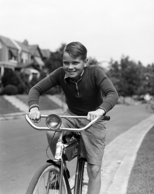 1930s Smiling Boy Riding Bicycle Poster Print By Vintage Collection (22 X 28) - Item # PPI177089LARGE