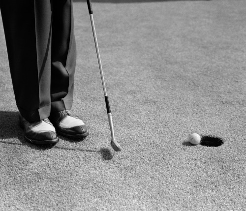 1950s Man Knees Down Putt On Golf Green Poster Print By Vintage Collection (32 X 36) - Item # PPI187282LARGE