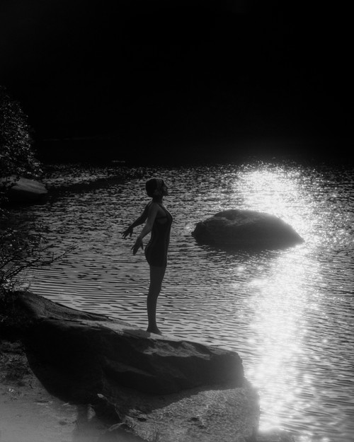 1920s Sunset Silhouette Of Woman Standing On A Rock Near Water About To Dive In Print By Vintage Collection - Item # VARPPI172455