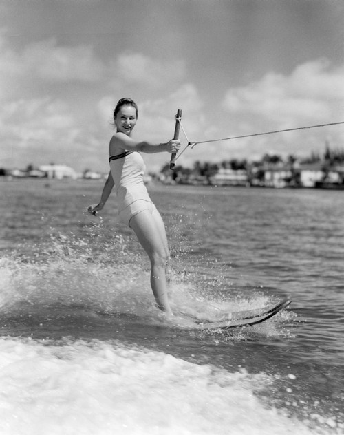 1950s Smiling Woman In Bathing Suit Water Skiing Waving One Hand Looking At Camera Print By Vintage Collection - Item # VARPPI176516