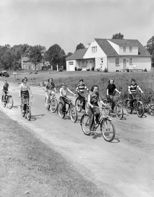 1950s Group Of 8 Kids Boys And Girls Riding Bicycles On Country Rural Road House In Background Print By Vintage - Item # VARPPI176982