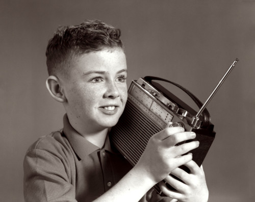 1960s Boy Listening To Portable Radio Indoor Poster Print By Vintage Collection (22 X 28) - Item # PPI178845LARGE