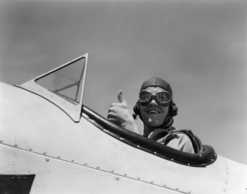 1940s Smiling Army Air Corps Pilot In Open Cockpit Wearing A Leather Flying Helmet Giving A Thumbs-Up Sign Print By - Item # PPI176407LARGE
