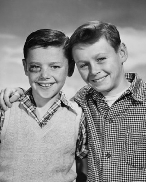 Portrait of a boy with a black eye smiling with another boy standing beside him Poster Print - Item # VARSAL25516457G