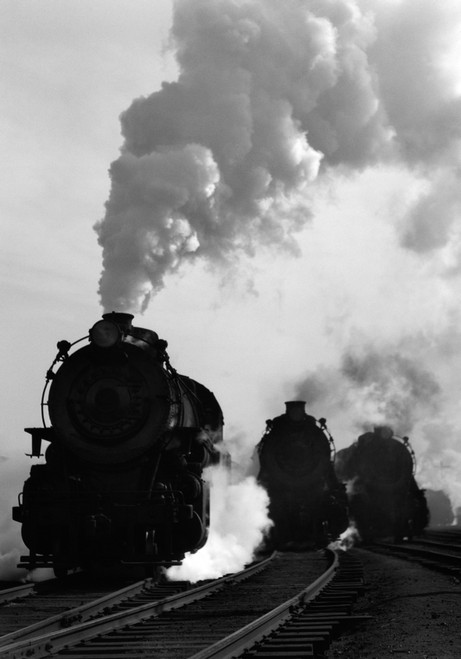 1930s-1940s Head-On View Of Three Steam Engines Silhouetted Against Billowing Smoke And Steam Outdoor Print By Vintage - Item # PPI172438LARGE