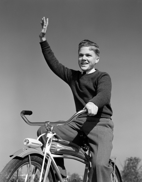 1940s-1950s Smiling Boy Riding Bike Waving Arm In Air Poster Print By Vintage Collection - Item # VARPPI177163
