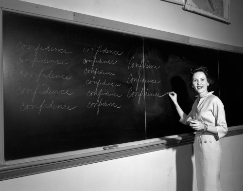 1950s Teacher In Front Of Classroom Writing Confidence On Blackboard Poster Print By Vintage Collection - Item # VARPPI172467