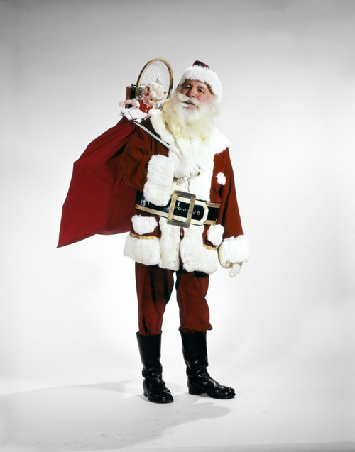 1960s Full Length Portrait Of Santa Claus With Stuffed Toy Sack On His Back Studio Print By Vintage Collection - Item # PPI177495LARGE