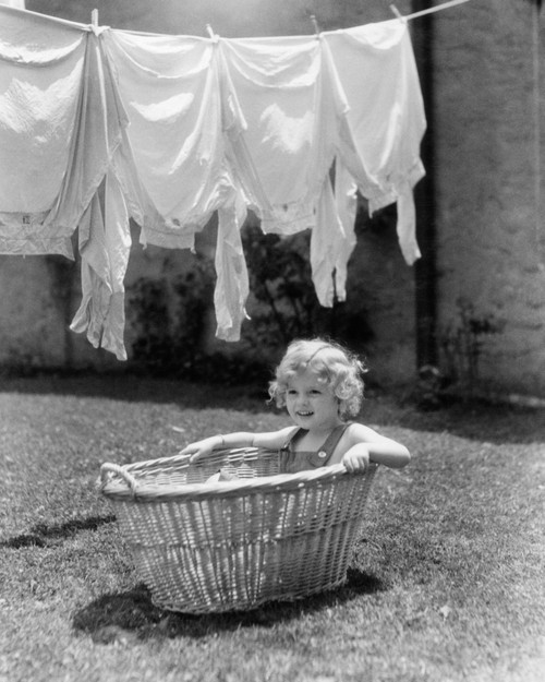 1930s-1940s Girl Outdoors Sitting In Laundry Basket Under Clothesline Full Of Shirts Print By Vintage Collection - Item # PPI177433LARGE