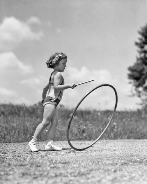 1930s Girl Outdoors Rolling A Hoop Playing Hoop And Stick Game Poster Print By Vintage Collection - Item # VARPPI177425
