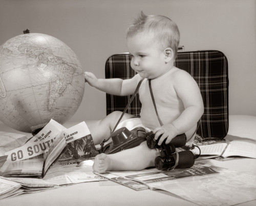 1960s Baby Seated Looking At Globe With Camera Binoculars Suitcase And Travel Brochures Print By Vintage Collection - Item # PPI177081LARGE