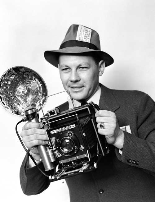 1930s-1940s-1950s Press Photographer Man Holding Speed Graphic Camera With Flash Bulb Illumination Print By Vintage - Item # PPI172476LARGE
