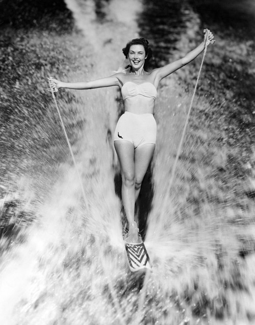1950s Smiling Woman In White Two Piece Bathing Suit Aquaplaning Water Skiing Looking At Camera Print By Vintage - Item # VARPPI176460