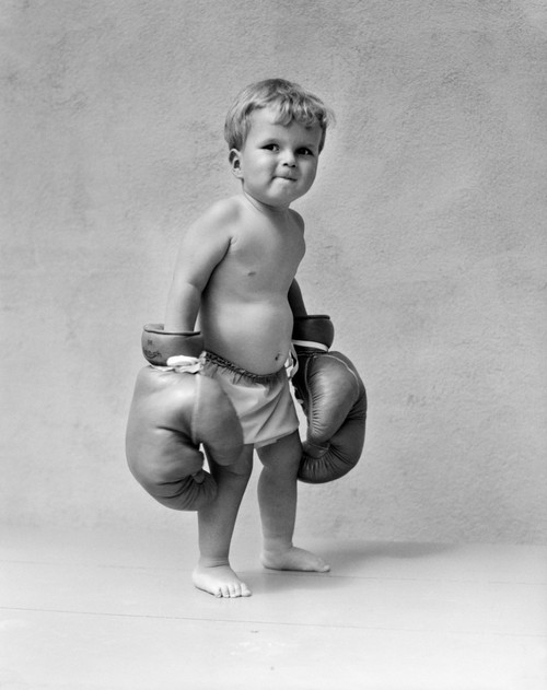 1930s Baby Boy Toddler Wearing Oversize Boxing Gloves Poster Print By Vintage Collection (22 X 28) - Item # PPI176991LARGE