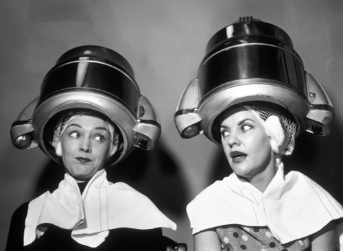 1950s Two Women Sitting Together Gossiping Under Hairdresser Hair Dryer Poster Print By Vintage Collection (24 X 36) - Item # PPI172464LARGE