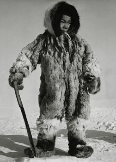 Eskimo boy standing on ice and holding a knife Poster Print - Item # VARSAL990118175