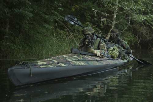 Navy SEALs navigate the waters in a folding kayak during jungle warfare operations Poster Print - Item # VARPSTTWE300001M