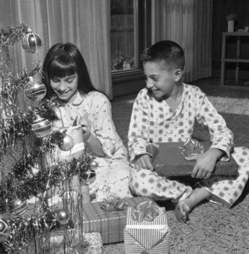 Happy children with Christmas gifts near Christmas tree Poster Print - Item # VARSAL255417398