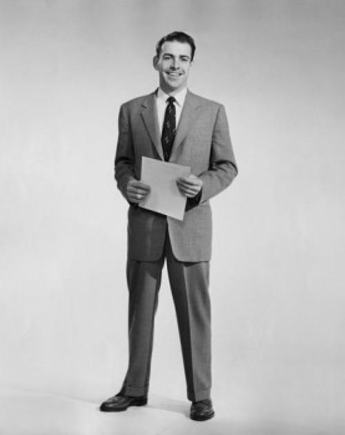 Studio portrait of businessman holding document Poster Print - Item # VARSAL25548100