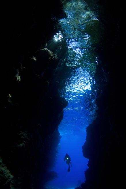 A diver explores the amazing underwater cavern known as Lerus Cut, Russell Islands, Solomons Poster Print - Item # VARPSTSJN400242U