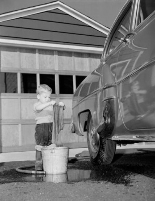 Boy washing car in front of house Poster Print - Item # VARSAL255799A